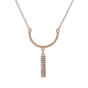 """Dainty rose gold tone necklace set with a curved bar pendant and clear rhinestone accents. Approximately 16"""" in length."""