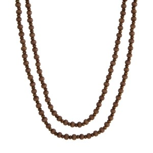 "Wooden wrap necklace with brown wooden and faceted beads. Approximately 80"" in length."