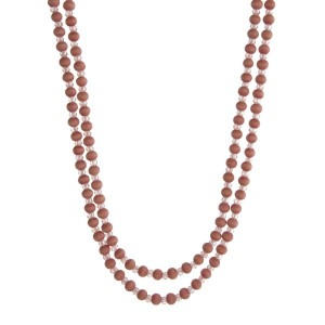 "Wooden wrap necklace with pink wooden and faceted beads. Approximately 80"" in length."