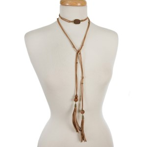 """Brown faux suede wrap necklace with wooden beads and gold tone accents. Approximately 60"""" in length."""