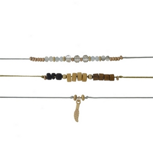"""Gray and gold cord three piece choker set with wooden and gray beaded accents. All chokers are approximately 12"""" in length."""