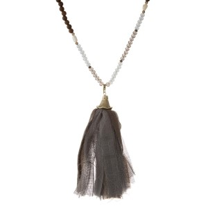 """Gray, light blue and brown beaded necklace with a gray fabric tassel. Approximately 32"""" in length."""
