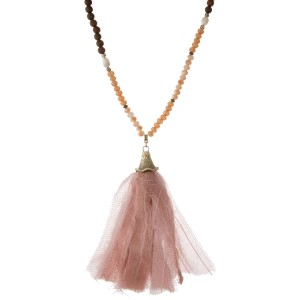 "Champagne, peach and brown beaded necklace with a pink and ivory fabric tassel. Approximately 32"" in length."