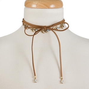 "Brown faux leather wrap choker with gold tone and opal rhinestone accents. Approximately 12"" in length."