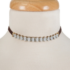 """Brown faux leather choker with opal rhinestones and gold tone accents. Approximately 12"""" in length."""