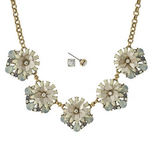"Gold tone necklace set with champagne, ivory and opal rhinestone and sequin flowers, and matching stud earrings. Approximately 16"" in length."