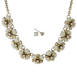 "Burnished gold tone necklace set with ivory stone flowers and matching stud earrings. Approximately 16"" in length."
