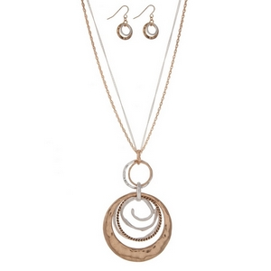 "Two tone necklace set with a swirl and circle pendant and matching fishhook earrings. Approximately 32"" in length."