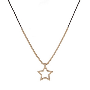 """Black cord necklace with a gold tone star pendant. Approximately 12"""" in length."""