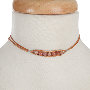 """Brown waxed cord choker with peach natural stone beads. Approximately 12"""" in length."""