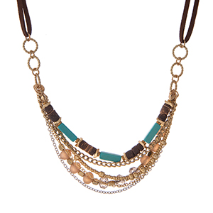 "Brown faux suede and gold tone necklace with turquoise, brown and champagne beads. Approximately 16"" in length."