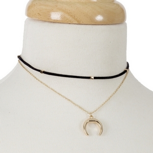 """Gold tone and black faux suede layered choker with a crescent pendant and matching stud earrings. Approximately 12"""" in length."""