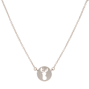 "Dainty silver tone necklace with a circle pendant displaying the cutout of a deer head. Approximately 16"" in length."