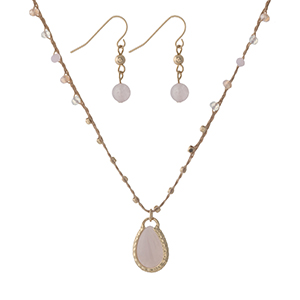 "Tan cord necklace set with a pink teardrop stone pendant and matching fishhook earrings. Approximately 14"" in length."