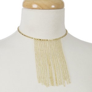 Gold tone beaded memory wire choker with metal fringe. Choker does not close, so it can fit almost any size.