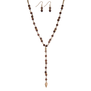 "Gold tone 'Y' necklace with brown beads and a dainty arrowhead pendant. Approximately 18"" in length."
