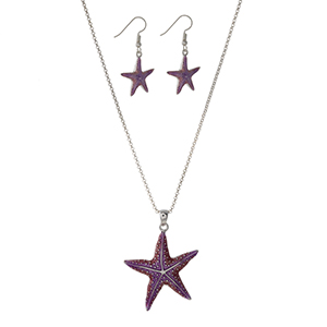 "Silver tone necklace set with a pink and purple ombre starfish pendant and matching fishhook earrings. Approximately 21"" in length."