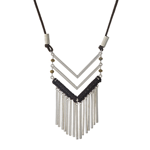 "Brown faux suede and silver tone necklace with a chevron pendant. Adjustable up to 32"" in length."