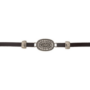 "Brown faux leather choker with a clear rhinestone pave focal. Approximately 12"" in length."