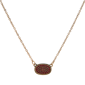 "Dainty gold tone necklace with a red rhinestone pendant. Approximately 16"" in length."