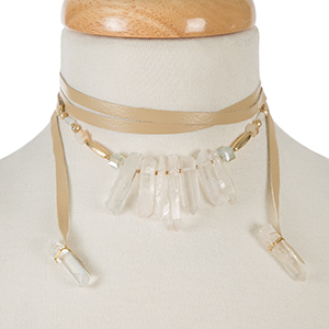 "Beige leather wrap necklace with white crystals and gold tone accents. Approximately 58"" in length."