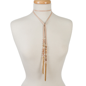 "Pink leather wrap necklace with peach beads and chain tassels. Approximately 52"" in length."