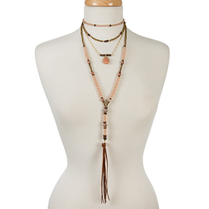 """Bronze, champagne, and peach beaded layered necklace with natural stones and a tassel pendant. Approximately 12"""" in length."""