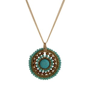 "Gold tone necklace with a turquoise and bronze beaded pendant. Approximately 32"" in length."