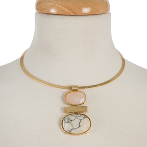"Gold tone metal choker with a pink and white two stone pendant. Approximately 5.5"" in diameter."