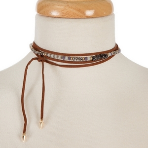"""Brown faux suede wrap necklace with gray semi-precious and iridescent beads and an asymmetrical length. Approximately 60"""" in length."""