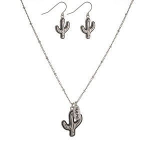 "Dainty silver tone necklace set with a cactus pendant and matching fishhook earrings. Approximately 16"" in length."
