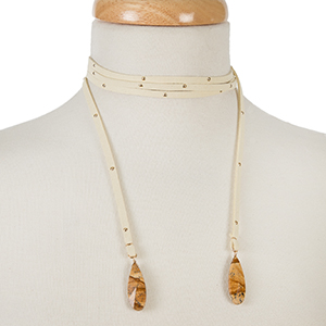 """Tan faux suede wrap necklace with gold tone studs and picture jasper stones on the ends. Approximately 64"""" in length."""