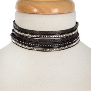 """Black faux leather and silver tone choker set featuring three chokers, all accented with clear rhinestones. Approximately 12"""" in length."""
