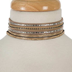 "Three piece, silver tone choker set with clear rhinestones and a tan snake skin pattern. All chokers measure 12"" in length."