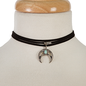 "Black faux suede choker with a burnished silver tone crescent pendant, accented with a turquoise stone. Approximately 12"" in length."