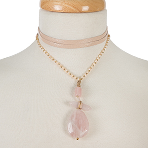 "Gold tone and pink leather wrap choker necklace with a three stone pink pendant. Approximately 66"" in length."