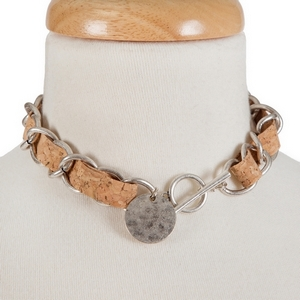 "Silver tone and cork necklace with a toggle closure. Approximately 13"" in length."