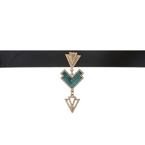"Black faux leather choker with a turquoise and gold tone focal. Approximately 12"" in length."