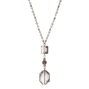 "Silver tone necklace set with gray beads and a faceted gray stone pendant. Approximately 36"" in length."