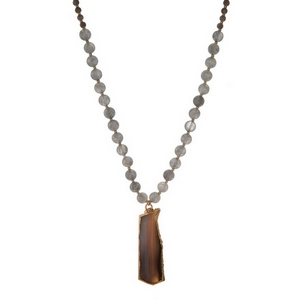 """Gray beaded necklace with a gray natural stone pendant and gold tone accents. Approximately 32"""" in length."""