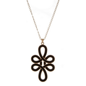 "Gold tone necklace displaying a swirled pendant with a black rope design. Approximately 32"" in length."