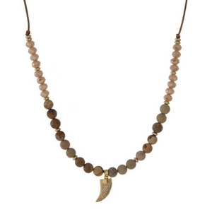 """Brown cord necklace with picture jasper natural stone beads, champagne faceted beads and a gold tone horn pendant. Approximately 16"""" in length. Handmade in the USA."""