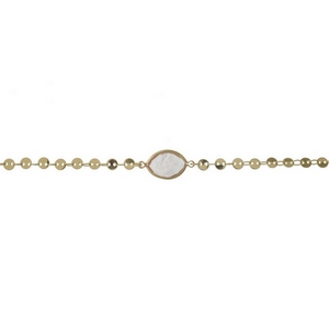 "Dainty gold tone choker with a peach stone focal. Approximately 12"" in length."