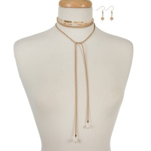 """Tan faux suede beaded wrap necklace with gold tone accents and matching fishhook earrings. Approximately 82"""" in length."""