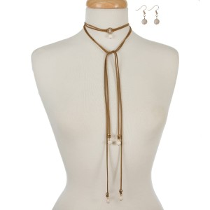 """Brown faux suede wrap necklace with ivory stone accents and matching fishhook earrings. Approximately 60"""" in length."""