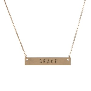 "Matte gold tone bar necklace stamped with ""Grace."" Approximately 14"" in length."