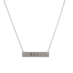 "Matte silver tone bar necklace stamped with ""Mrs."" Approximately 14"" in length."