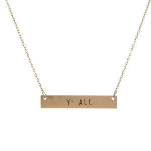 "Matte gold tone bar necklace stamped with ""Y'all."" Approximately 14"" in length."