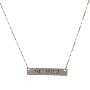 "Matte silver tone bar necklace stamped with ""Free Spirit."" Approximately 14"" in length."