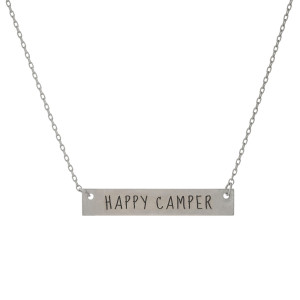 "Matte silver tone bar necklace stamped with ""Happy Camper."" Approximately 14"" in length."